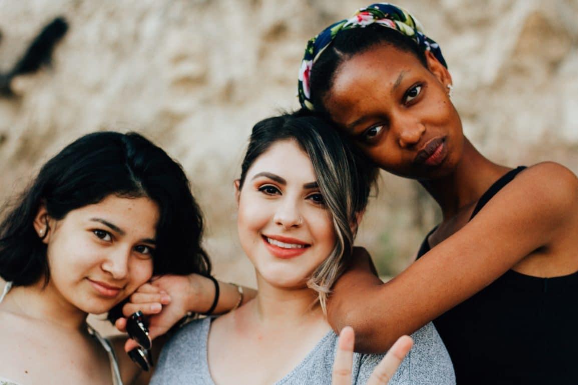 Three girls smiling at the camera