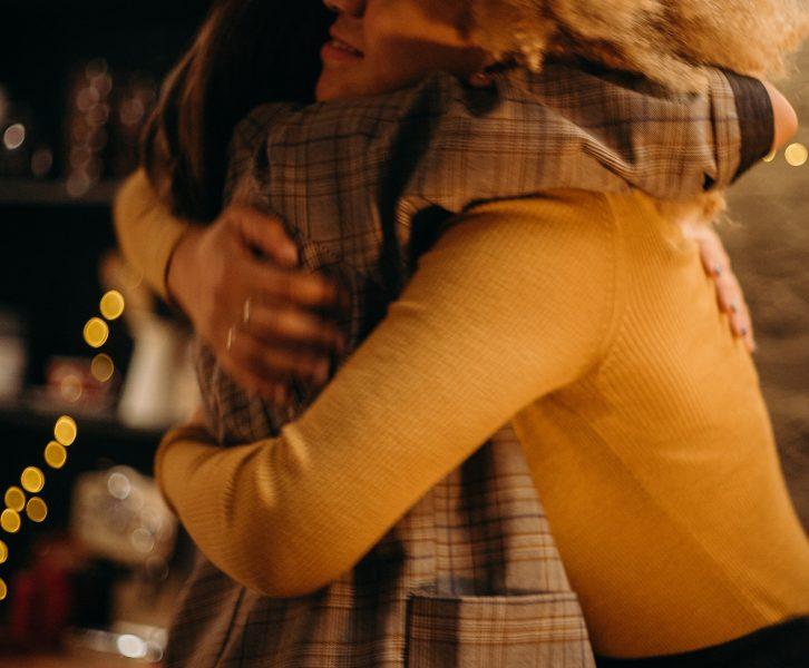 two people embrace in hugs