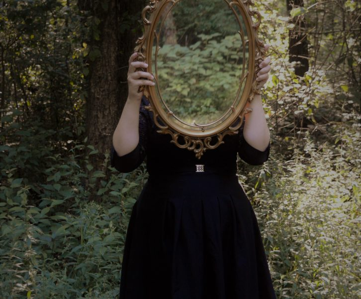 Girl holding up mirror