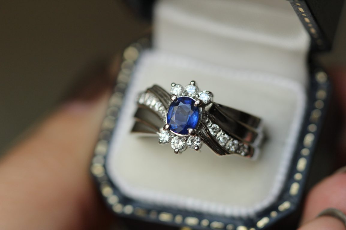 blue gemstone ring in ring box